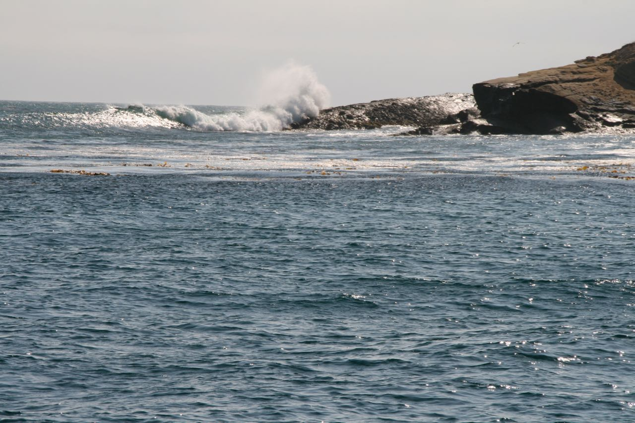 Moor about midpoint in the bight to avoid westerly swell.